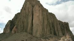 Slow upward pan of New Mexico's Shiprock. Stock Footage