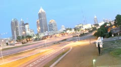 Lights brighten in downtown Atlanta, Georgia and its surrounding highways as Stock Footage
