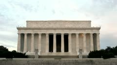 Pedestrians and tourists walk around and through the Lincoln Memorial in Stock Footage