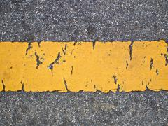 yellow line on the road - stock photo