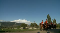 Military, Horse troop marching at sunset, in full ceremonial uniform Stock Footage