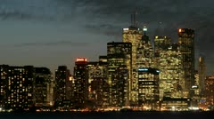 The Toronto skyline sparkles with light under the darkening sky. Stock Footage