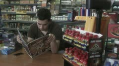 Lazy convenience store clerk Stock Footage