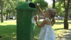 Child Throwing the Napkin in Garbage, Little Girl put Tissue in Trash, Children - stock footage