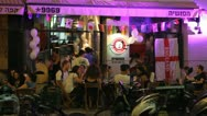 Stock Video Footage of 590  young people sit in a restaurant and chat