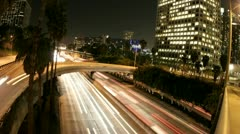 Time-lapse of Los Angeles city traffic on a downtown highway at night. Stock Footage