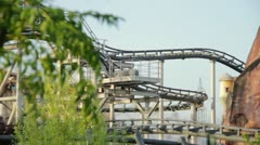 Line of dragon roller coaster rail Stock Footage