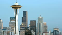 Slow left-pan of the Seattle Space Needle and the surrounding buildings in Stock Footage