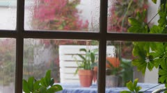 View of rain pouring down window Stock Footage