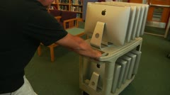 Apple Computers being brought into school Stock Footage