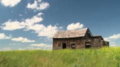 Time-lapse, old outbuilding and clouds on farm Stock Footage