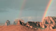 Slow right pan of a double rainbow fading until only one remains. Stock Footage