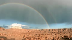 A rainbow arches over Goblin Valley State Park. Stock Footage