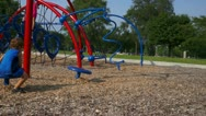 Cute Little Boy Playing At Playground Stock Footage