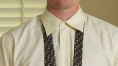 Close up of man tying tie - stock footage