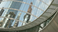 Skyscrapers reflect in the mirrored walls of the Houston Oil Company building. Stock Footage