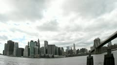 Thick, white clouds pass over the New York City skyline. Stock Footage