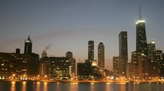 Lights brighten as the sky darkens in downtown Chicago. Stock Footage