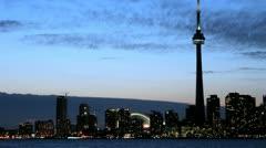 The Toronto skyline brightens as the sky darkens. Stock Footage