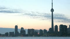The Toronto skyline brightens as the colorful sky darkens. Stock Footage