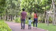 Stock Video Footage of young happy family walking together in the park