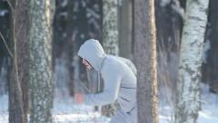 A man running through the winter forest Stock Footage