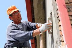 Mason Worker Plastering Wall Stock Photos
