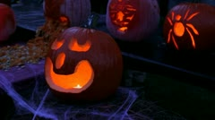 Halloween pumpkin jack-o-lanterns lighted with candles at night Stock Footage