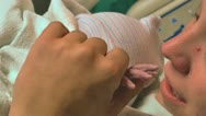 Mother holds newborn baby's hand first time Stock Footage