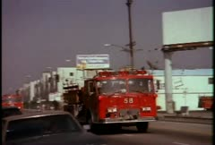 Stock Video Footage of Fire trucks responding during the LA riots in 1992.