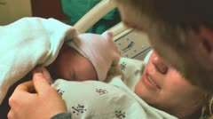 New parents with newborn baby hospital close up Stock Footage
