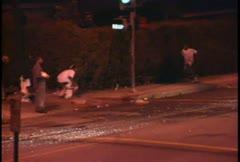 People rioting at night during the LA Riots. Stock Footage