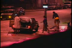 Looters walk the streets at night during the LA Riots. - stock footage