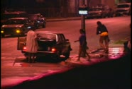 Looters walk the streets at night during the LA Riots. Stock Footage