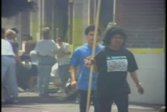 Communities work to clean up after looting during the LA Riots. - stock footage