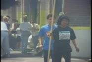 Communities work to clean up after looting during the LA Riots. Stock Footage