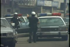 Stock Video Footage of Police direct traffic during the LA Riots.