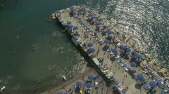 Santa Marinella (near Sorrento) beach bathers (1) aerial view. Slo mo Stock Footage