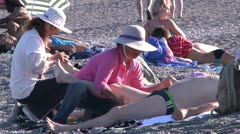 Chinese massage on italian beach. - stock footage
