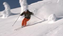 Strong skier makes nice turns through deep dry powder - stock footage