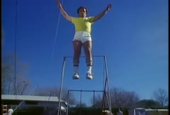 A retro man jumps on a trampoline. Stock Footage