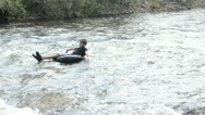 Stock Video Footage of adventurous boy braves the rapids