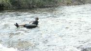 Adventurous boy braves the rapids Stock Footage