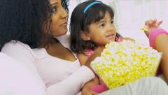 Young Ethnic Mother Daughter Eating Popcorn Stock Footage