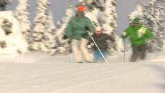 Expert skiers make fast tight turns on ski run - stock footage