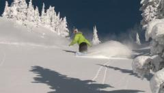 Snowboarders ride powder in steep terrain - stock footage