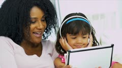 Close Up Ethnic Mom Child Using Tablet Technology Stock Footage