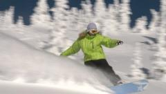 Snowboarder carves through beautiful powder on bright sunny day. - stock footage