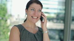 Happy businesswoman talking on cellphone, steadicam shot HD - stock footage