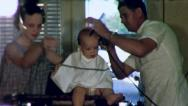 Stock Video Footage of BABYS FIRST HAIRCUT 1952 Barber Shop (Vintage Home Movie Film Footage) 3024